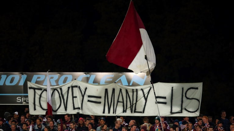 Our man: Sea Eagles supporters show their support for axed coach Geoff Toovey.