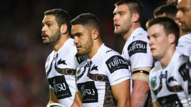 No answers: Rabbitohs players look shell-shocked after their hammering.