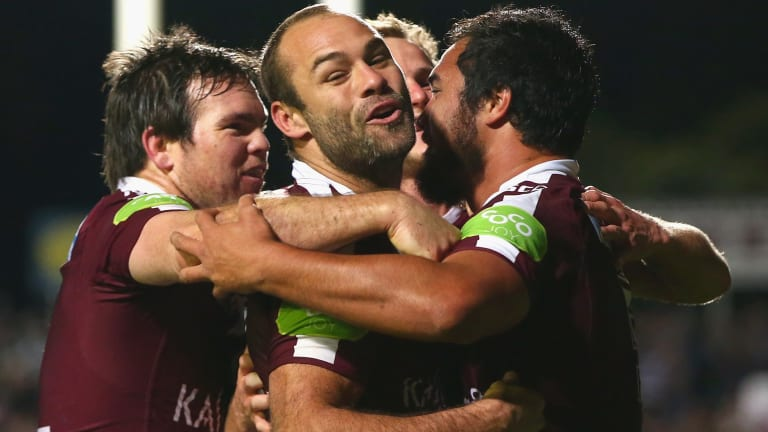 Surging up the table: Manly's Jamie Lyon, Brett Stewart and Daly Cherry-Evans  celebrate with Peter Hiku after he scored.