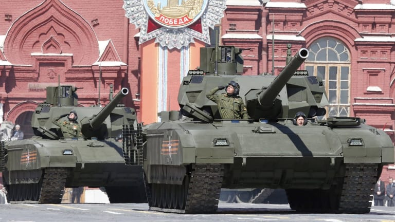 Russian servicemen drive T-14 Armata tanks during a rehearsal for the Victory Day parade in Red Square.