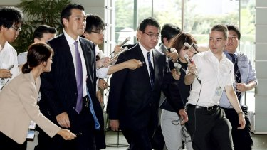 Japanese Foreign Minister Taro Kono, centre, arrives at prime minister's official residence in Tokyo on Friday morning.