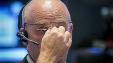 Rough day at the office: A trader working the floor on the New York Stock Exchange.