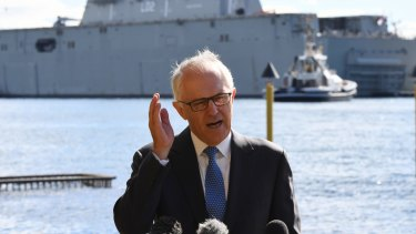 """And I enjoy fishing on the harbour with a few mates, like so many Australians do - why, I just bought this little runabout behind me, although I might see if they have one in blue so it better matches my… um, proletariat convictions."""