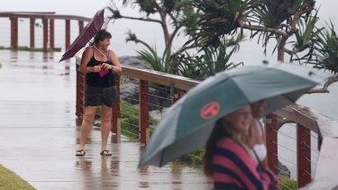People watch the waves at Duranbah on the Gold Coast.