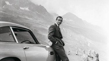 Sean Connery as James Bond, on location in Europe with his Aston Martin.