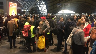 Stranded passengers at Southern Cross Station on Thursday.