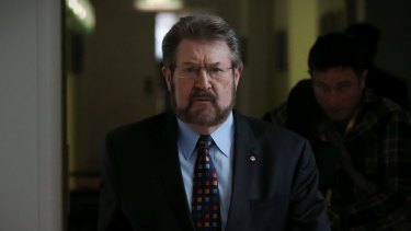 Senator Derryn Hinch uses parliamentary privilege to name 'monster' cop who raped children over 16 years.