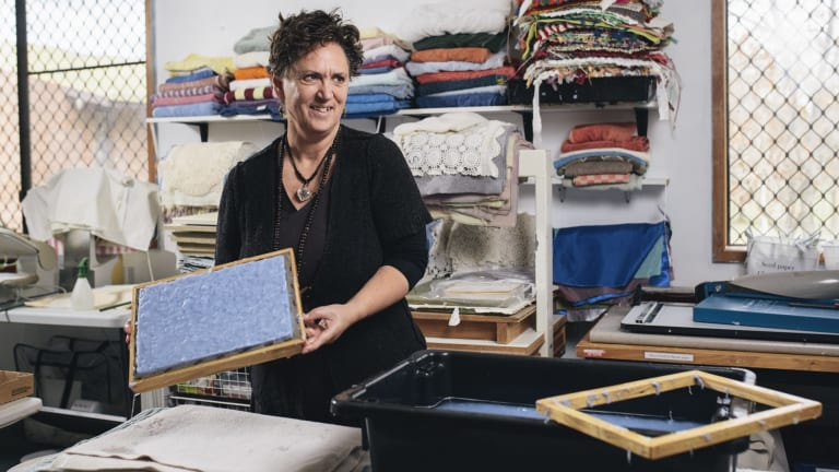 Artisan Sarah Sadler of Griffith making paper from old denim at Paperworks in Watson. She works at the organisation for one afternoon a week.