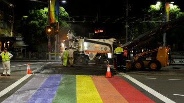 Roadworkers rip up the rainbow crossing in Oxford Street at Taylor Square on April 10, 2013.