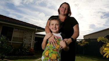 Jesse Burgess with his mother Paula. Paula has bought a border collie to be trained as a therapy dog as an alternative to drugs for ADHD.