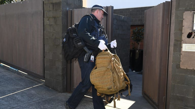Police search the home of John Ibrahim on Tuesday morning.