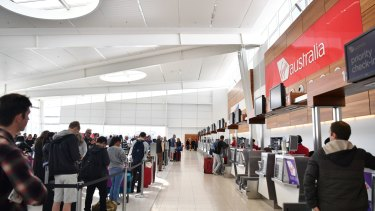 Queues at the Virgin Australia check-in area during its nationwide computer outage at Adelaide Airport on Sunday.