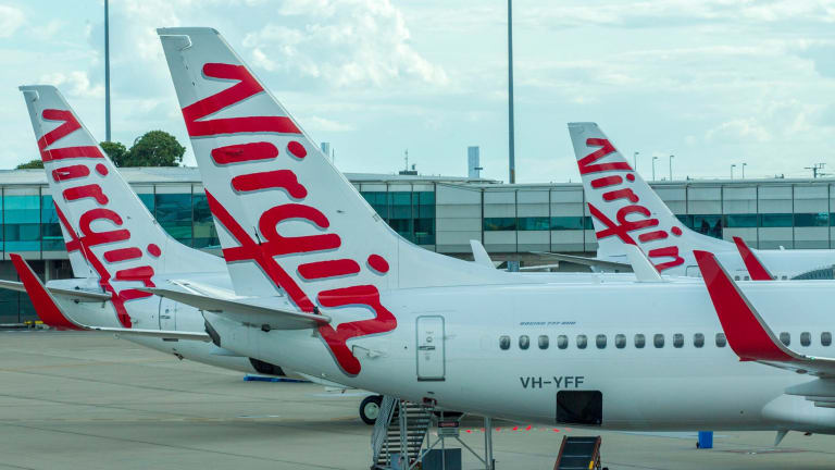 The ATSB has revealed a drone came close to colliding with a Virgin flight on approach to Brisbane Airport.