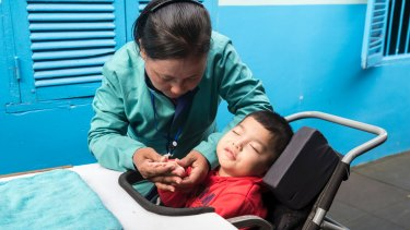 Carer Yan Saren works in a centre for children with special needs on the outskirts of Phnom Penh.
