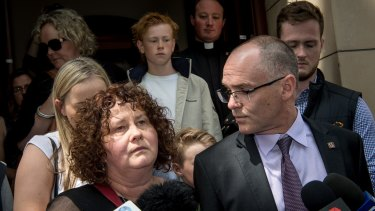 Patrick Cronin's parents Robyn and Matt speak outside court on Friday.