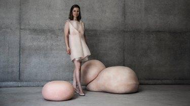 Artist Gigi Barker with her skin furniture.