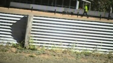 A screenshot of the <i>Four Corners</i> program on greyhound racing industry, allegedly filmed at trainer Tom Noble's property in Queensland.