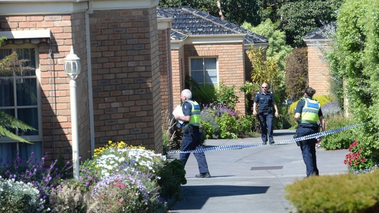 Police outside the block of units in Mitcham, where a man's body was found.