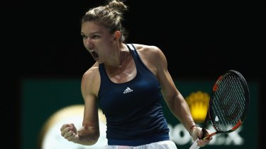 Romanian Simona Halep in action against American Madison Keys at the WTA Finals in Singapore.