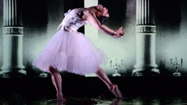 Water floods the stage like tears during Natalia Osipova's performance. Photo: Regis Lansac