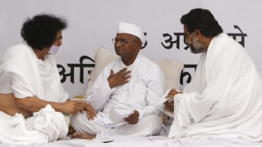 """Social activist Anna Hazare, centre, speaks with holy men belonging to the Jain community during a """"fast unto death"""" campaign in New Delhi in 2011."""