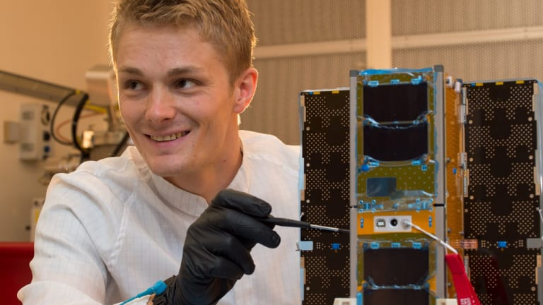 UNSW Canberra space test engineer Philippe Lorrain carries out initial acceptance tests on the BRMM (Buccaneer Risk Mitigation Mission) spacecraft bus from Pumpkin, Inc. Buccaneer CubeSat. supplied photo. 26 November 2017.