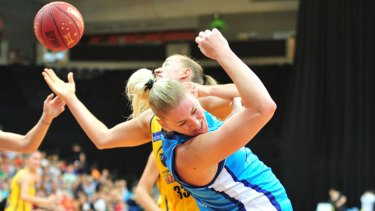 Former Sydney Flames player Mikaela Ruef  takes on her new team Canberra Capitals in 2015.