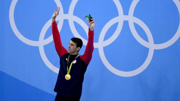 Gold No. 20: Michael Phelps of the US on the podium during the medal ceremony for the men's 200m butterfly final.
