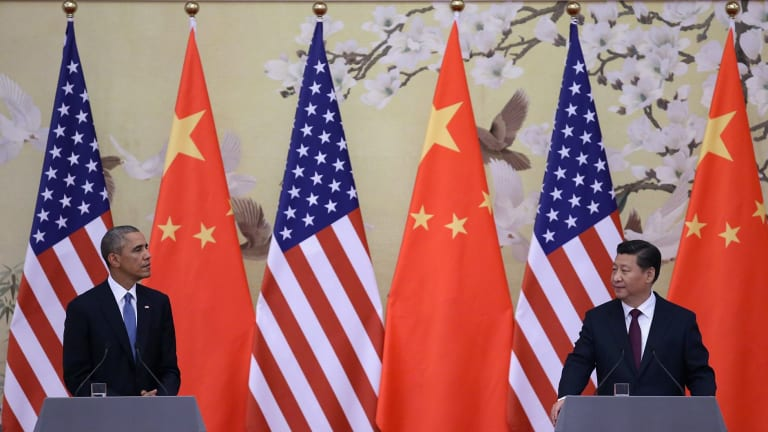 President Barack Obama, left,  and Chinese President Xi Jinping attend a press conference at the Great Hall of People in Beijing this week.