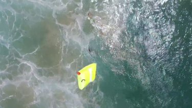 A drone has been used to save two swimmers struggling in heavy surf at Lennox Head.