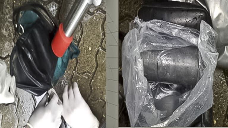 In this combination of images provided by the Moldova General Police Inspectorate in 2011, a sample of uranium-235 is tested for radioactivity in Chisinau, Moldova. Teodor Chetrus, a former KGB informant, was involved in the uranium's sale.