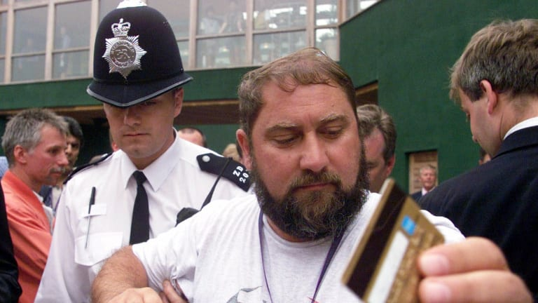 Damir Dokic, father of Jelena Dokic, is escorted by police from the media balcony at Wimbledon in 2000.