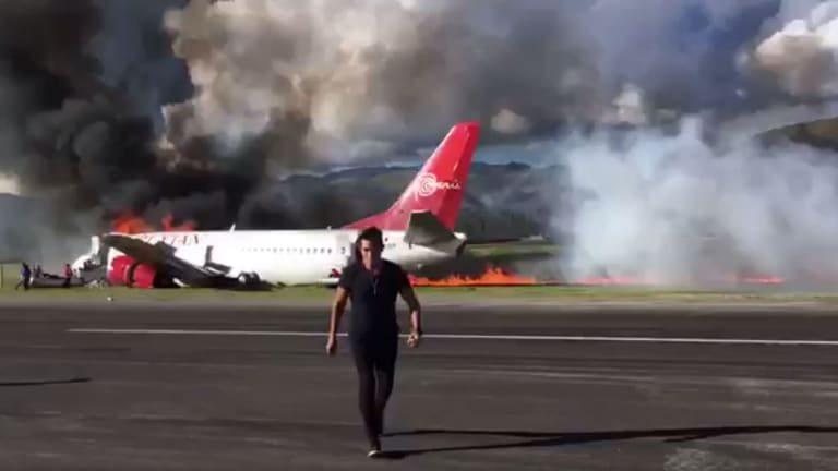 The Peruvian Airlines jet on the runway.
