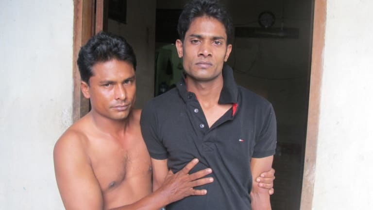 Mohammed Rosshad (right) is helped by his friend Mohammed Yusuf.
