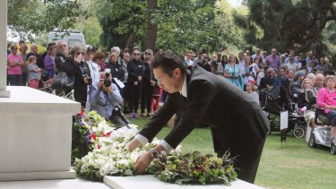 Japanese Parliamentary Vice-Minister for Foreign Affairs Hitoshi Kikawada offers flowers during a memorial ceremony in Christchurch on Monday.