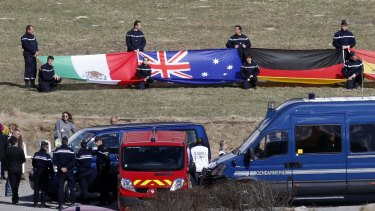The Australian flag is displayed at a ceremony to pay tribute March 30, 2015 to the two Australians among 150 victims of the Germanwings Airbus A320.