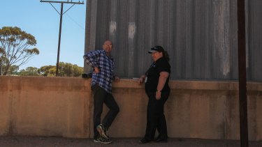 Patient Pete, 49, chats with mental health project officer Glynis Thorp outside an old corrugated iron shed.