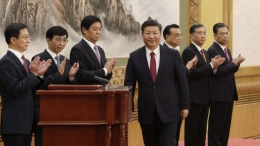 Chinese President Xi Jinping with other members of the Communist Party's new Politburo Standing Committee Han Zheng, from left, Wang Huning, Li Zhanshu, Li Keqiang, Wang Yang and Zhao Leji.