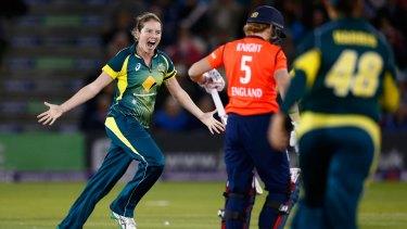 Rene Farrell of Australia celebrates taking the wicket of Heather Knight.