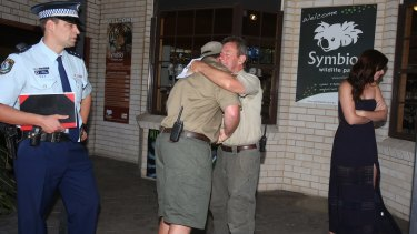 Symbio Wildlife Park owner John Radnidge, right, comforts supervisor Ryan Leahy after the theft.