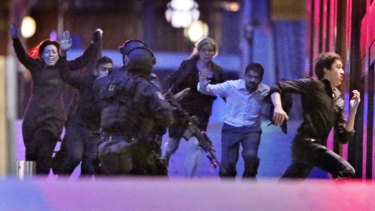 Hostages flee from the Lindt Cafe during the siege.