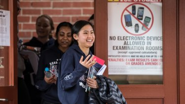 Year 12 students of Our Lady of Mercy College, Heidelberg breathe a sigh of relief after finishing the VCE English exam.