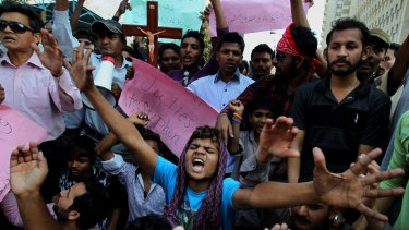Pakistani Christians in Karachi chant slogans during a demonstration to condemn the suicide bombing attack on two churches in Lahore.