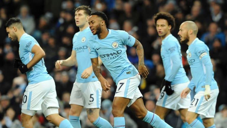 Manchester City's Raheem Sterling, centre, celebrates his goal.