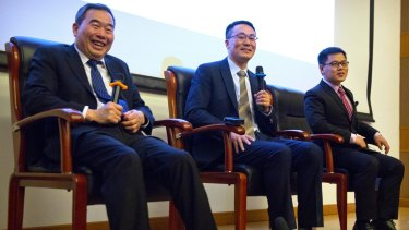 From left, Muming Poo, director of the Institute of Neurosciences at the Chinese Academy of Sciences; Qiang Sun, the director of the Nonhuman Primate Research Facility of the Institute of Neurosciences; and Zhen Liu, a postdoctoral researcher at the Institute of Neurosciences during a press conference in Beijing on Wednesday.