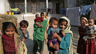 Displaced girls in a makeshift camp last month after their families fled an increasingly vicious war for control of Afghanistan's eastern region between the Taliban and Islamic State fighters.