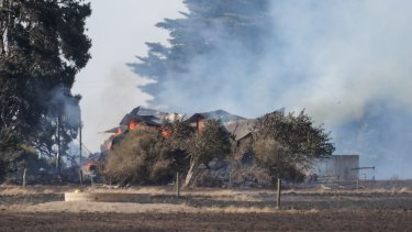 Flames take hold in a hay shed during the fire at Glenormiston in the state's west.
