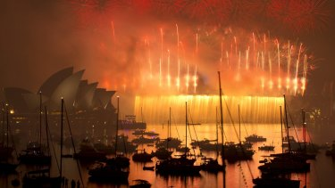 The bridge explodes in a dramatic fireworks display.