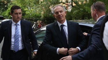 Tony Blair arrives back at his home after a press conference following the outcome of the Iraq Inquiry report.