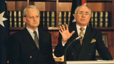 Mr Ruddock, as immigration minister, and with then prime minister John Howard.